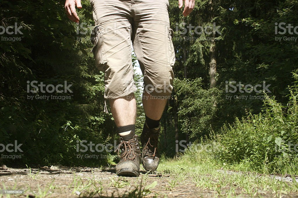 Legs with hiking boots of a wanderer royalty-free stock photo