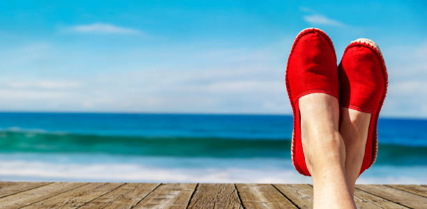 Legs with red cloth shoes in front of beach picture id1159832094?b=1&k=6&m=1159832094&s=612x612&w=0&h=umrsnjjy1a0wcg2crqw6dp0px6huphbkoudmqgqdj1w=