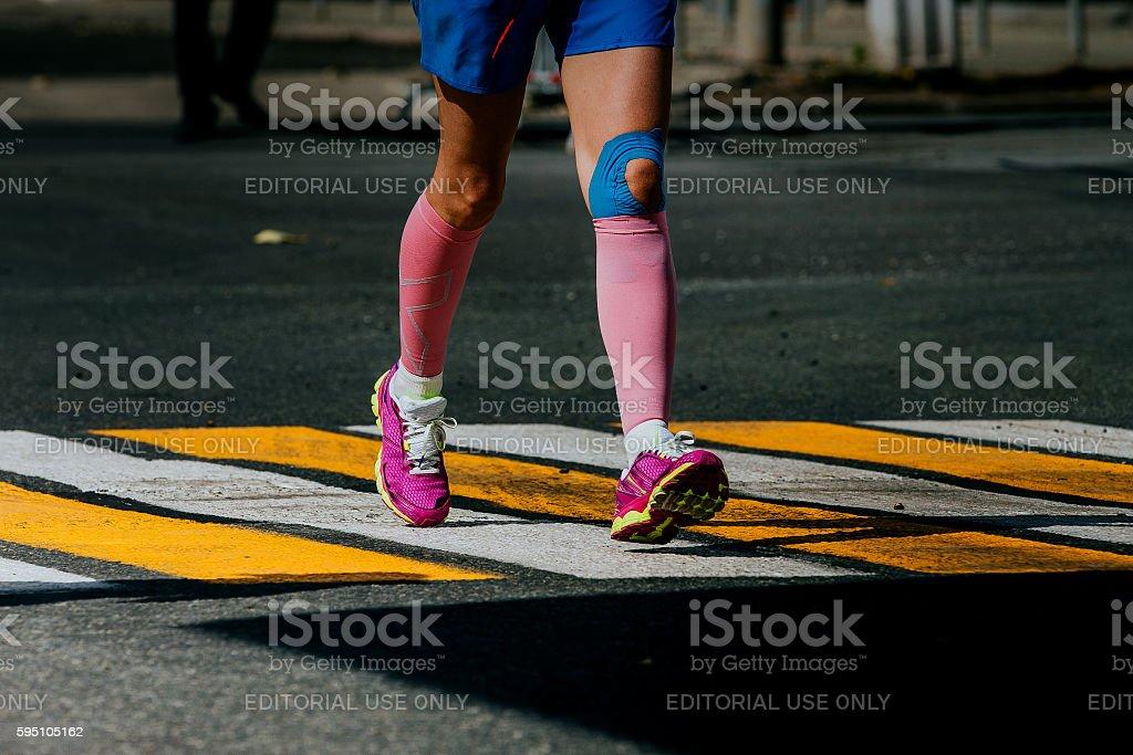 legs women athletes in compression socks stock photo