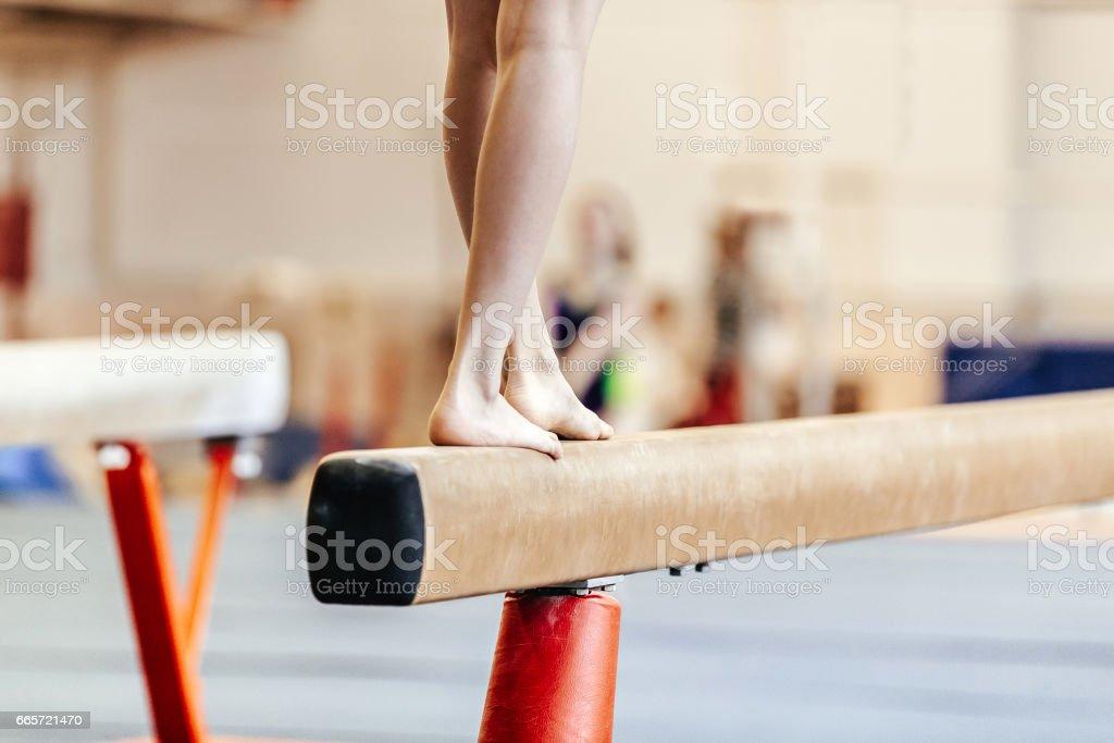 legs women gymnasts exercises on balance beam stock photo