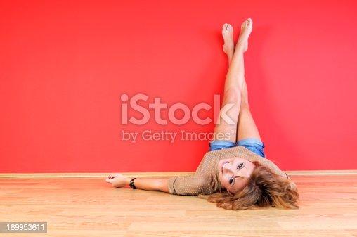 Young girl, legs-up, studio shot...