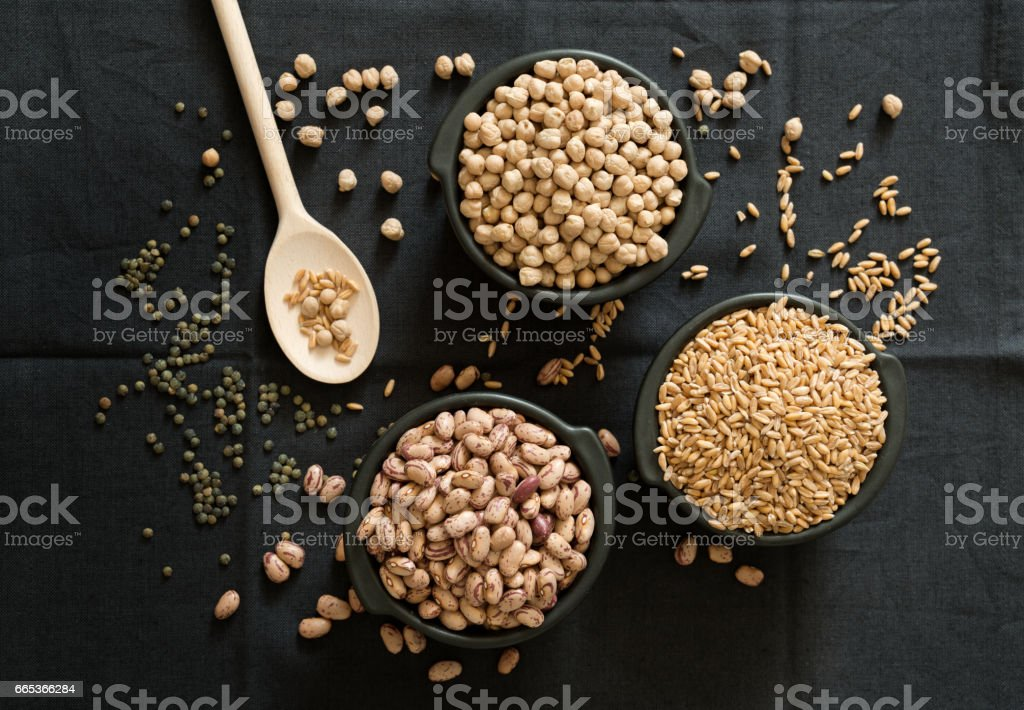 legume family in the black bowls on the table stock photo