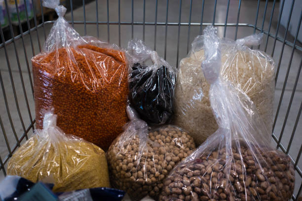 Legumes seen in a grocery cart. Rice, red lentil, olive, chickpea and kidney bean stock photo