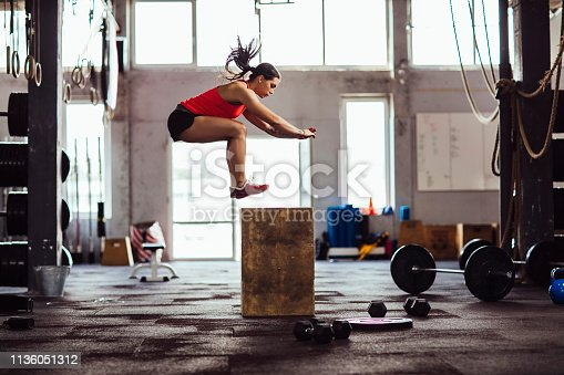 Women in the gym jumping and doing leg workout