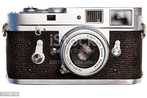 Montreal, Canada - February 23, 2016 : Leica classic and vintage M2 film camera circa 1957-67 seen from the front with lens cap off.