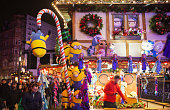 London, UK - November 30, 2014: Leicester square traditional fun fair with stools, carrousel, prises to win and Christmas activity. People and families enjoying Christmas mood night out