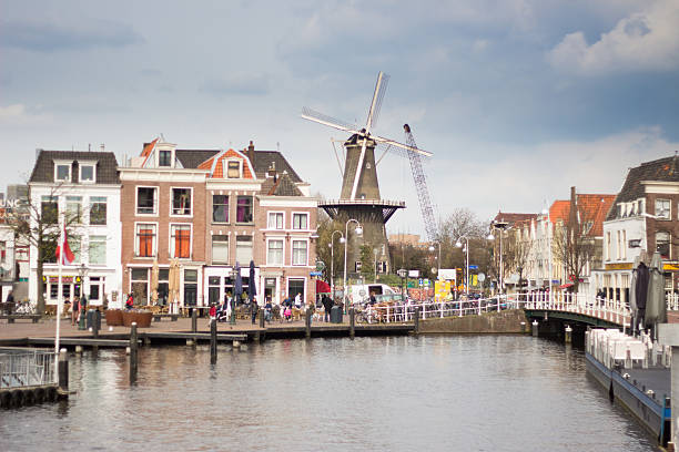 Leiden and its windmill during springtime A photography of Leiden, in the Netherlands, during Springtime. leiden stock pictures, royalty-free photos & images