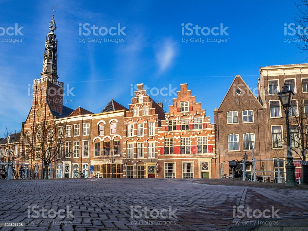 Leiden, Late afternoon sunlight hiding medieval houses. stock photo