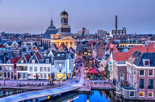 Leiden town in the blue hour Leiden, The Netherlands, February 24, 2018: Evening view of Stille Mare, Hartebrugkerk and Stille Rijn leiden stock pictures, royalty-free photos & images