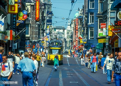 Tourists and locals shopping and strolling on the Leidsestraat (Leidse-street) onto the Leidseplein (Leidse-square). Scan off a 1984 slide.