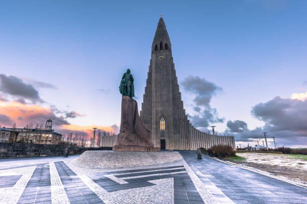 Reykjavik - May 01, 2018: Leif Erikson statue at the Hallgrimskirkja church in the center of Reykjaivk, Iceland Reykjavik - May 01, 2018: Leif Erikson statue at the Hallgrimskirkja church in the center of Reykjaivk, Iceland Hallgrímskirkja church stock pictures, royalty-free photos & images