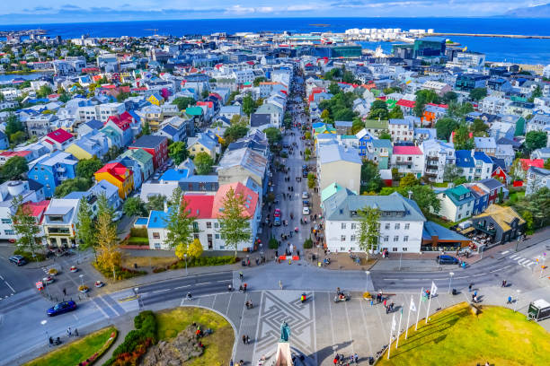 Leif Eriksson Statue Colorful Houses Streets Reykjavik Iceland Leif Eriksson Statue Colorful Red Blue Houses Cars Streets Harbor Reykjavik Iceland Hallgrímskirkja church stock pictures, royalty-free photos & images