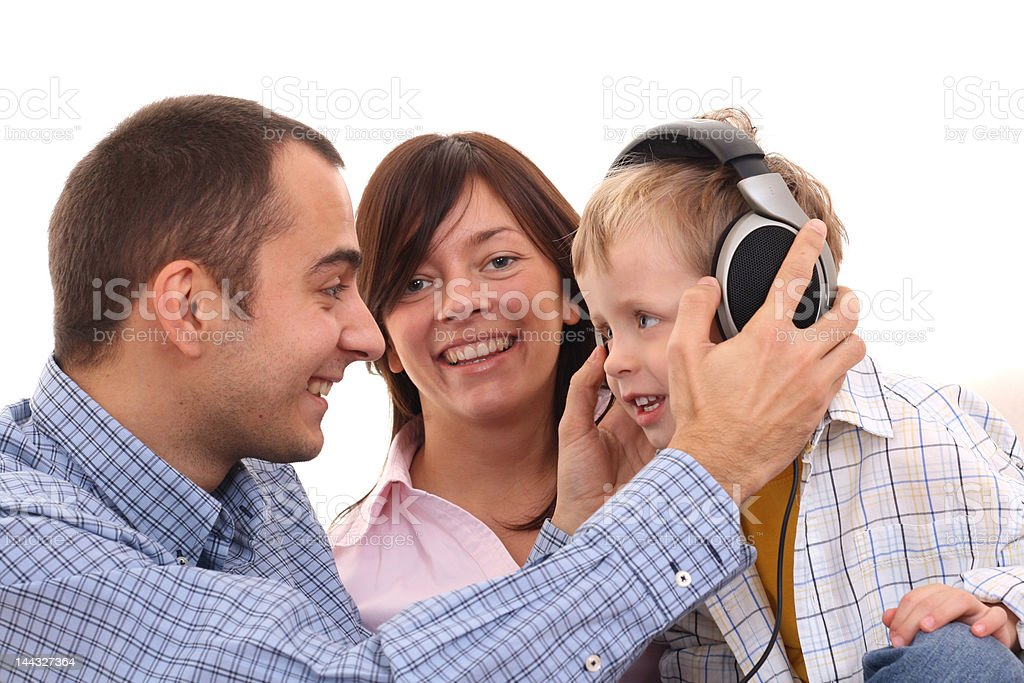 leisure activity - family mother father and son listen to music - leisure activity 2-3 Years Stock Photo