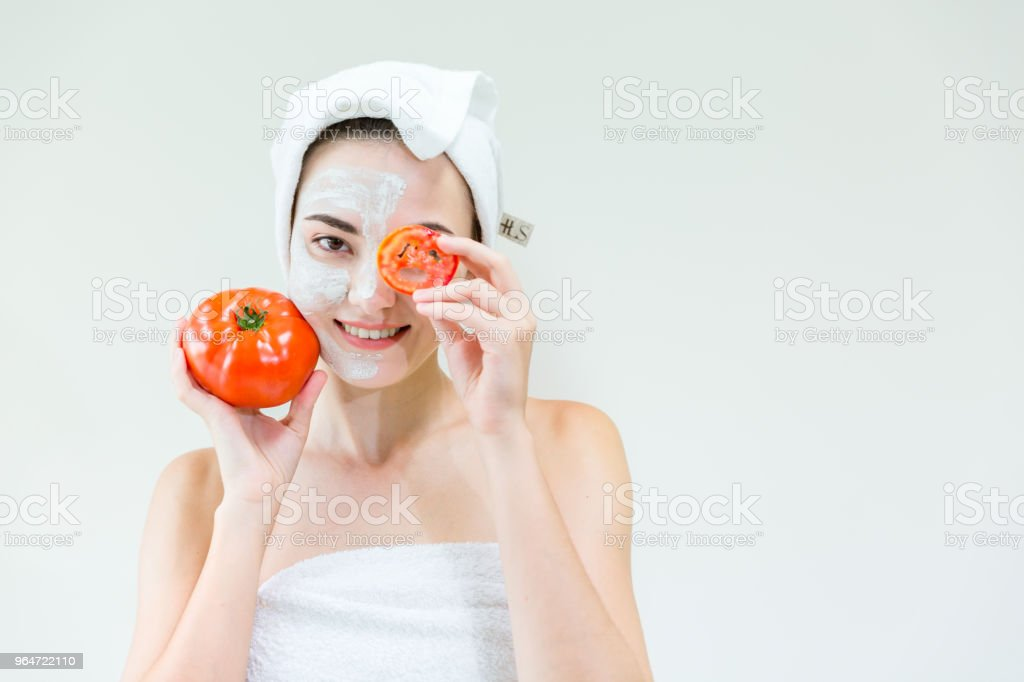 Leisure background, Beautiful girl is showing tomato and smile relaxing. Caucasian is feeling good about treatment in luxury spa, Healthy Concept and Beauty Background. royalty-free stock photo