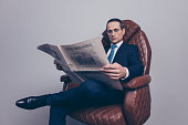 Leisure joy stylish leader leadership lifestyle economist banker freelancer posh respect chic classy elite wealth concept. Serious focused concentrated arrogant proud manager looking holding newspaper