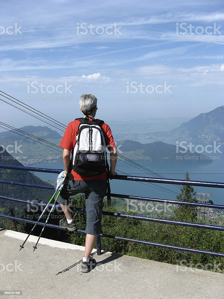 Leisure; Middle-aged female hiker enjoys panoramic viewpoint royalty-free stock photo