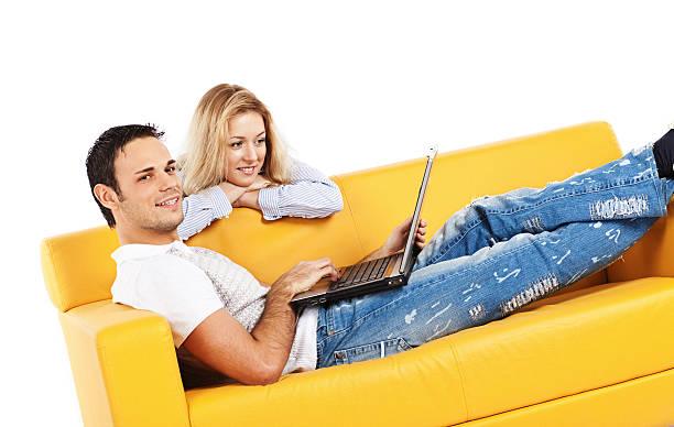 Leisure on bright yellow sofa stock photo