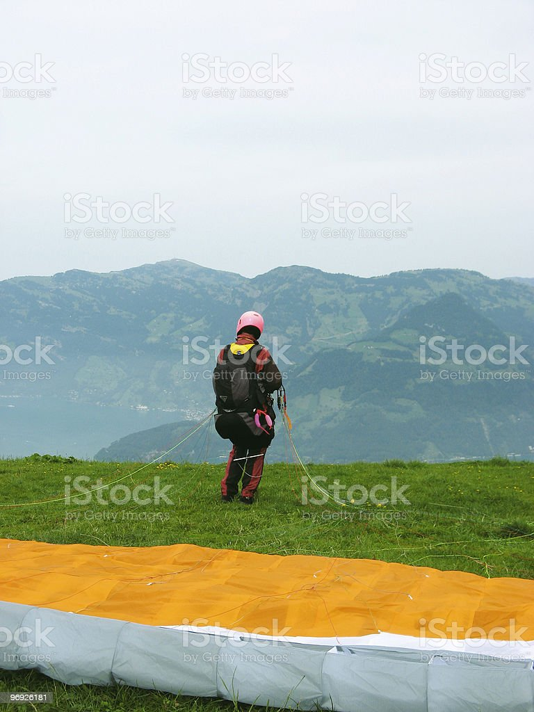 Leisure; Paraglider waiting for the right moment stock photo