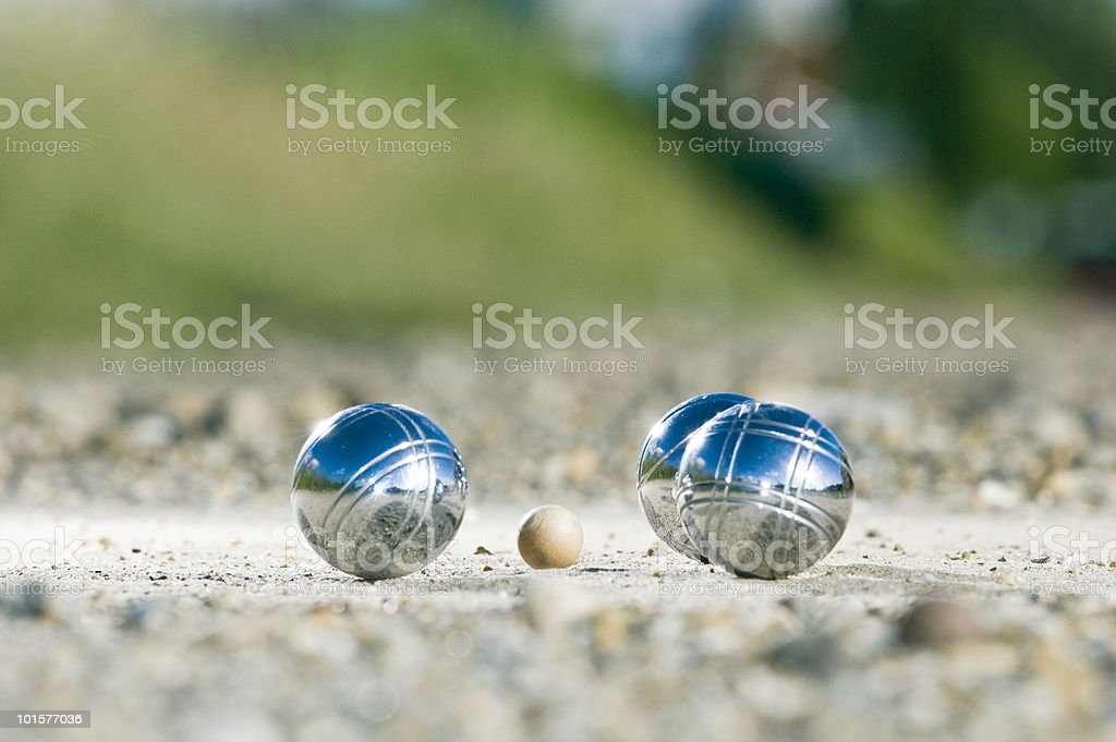 Leisure; Petanque balls close to the goal stock photo