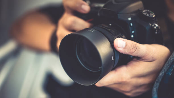 leisure photos - camera photographic equipment stock photos and pictures