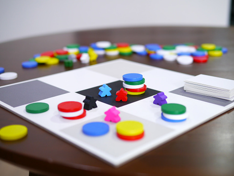 istock leisure playing fun board game on wooden table top selected focus 1179574547