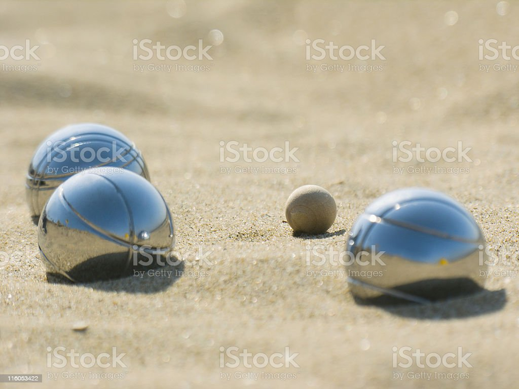 Leisure; Three petanque balls close to the goal stock photo