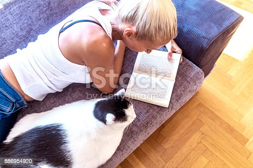 istock Leisure time with a cat 886954920