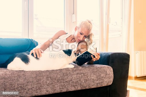 istock Leisure time with a cat 886958332