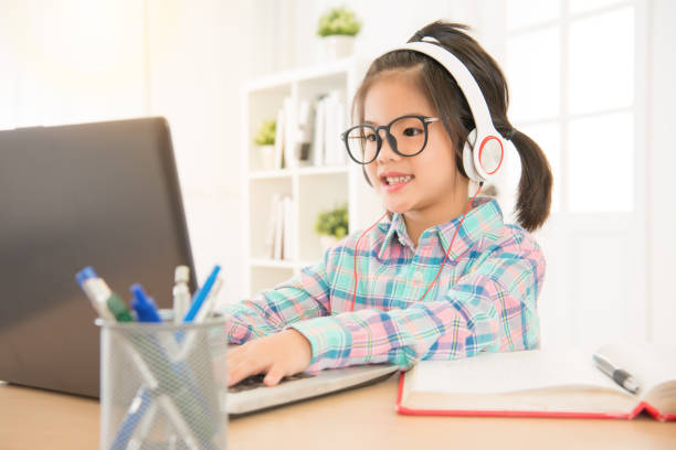 leisurely cute elementary kid seriously stock photo