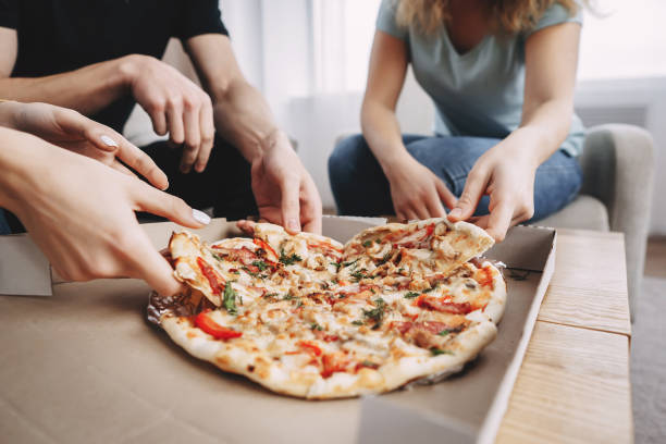 leisure,party, food delivery, friends eating pizza stock photo