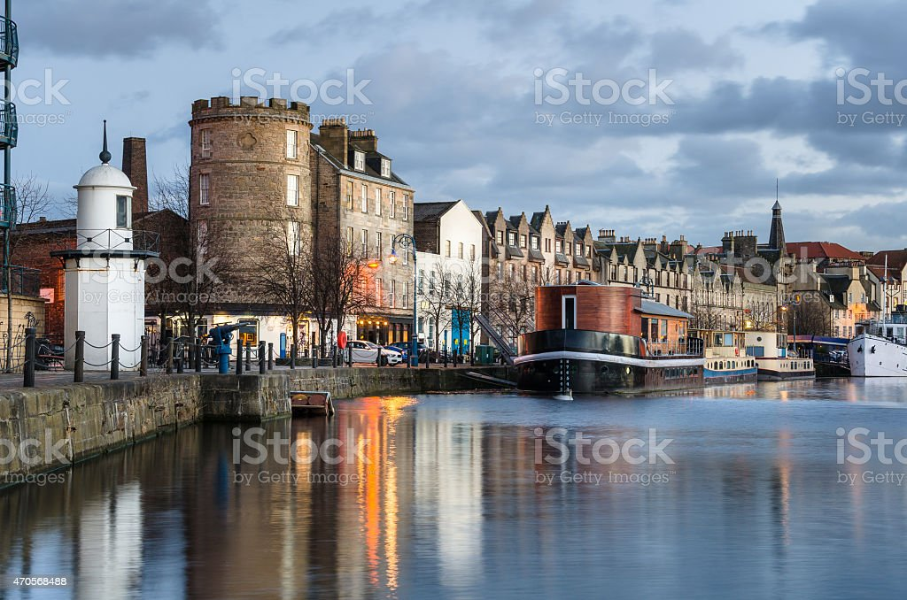 Leith Waterfront with Historical Building and old Boats at Sunset stock photo