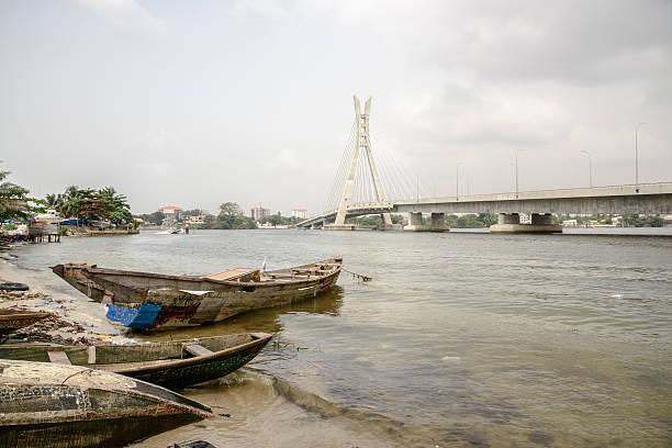 Lekki Ikoyi Bridge with fishing boat, Lagos, Nigeria stock photo