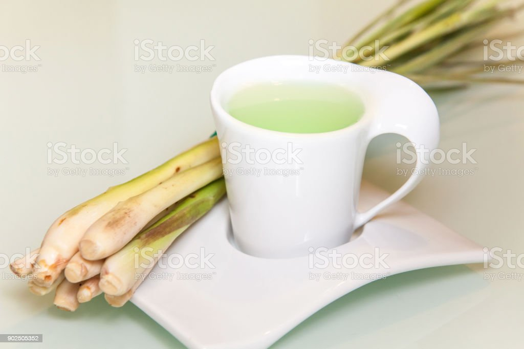 Lemmon grass drink with a white cup view in close up with blur isolated background stock photo