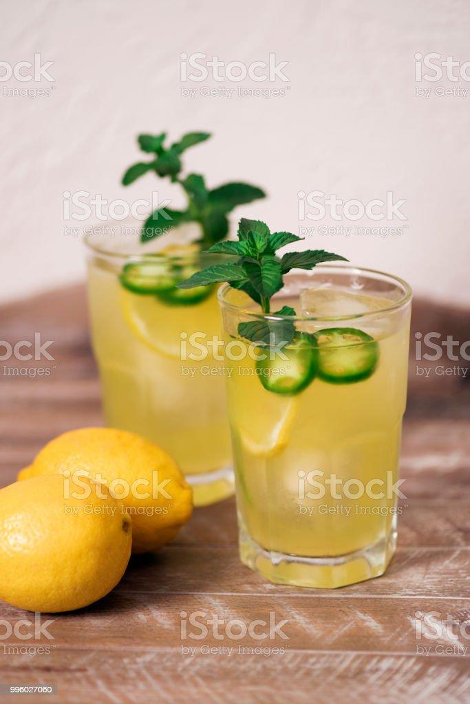 Lemon and jalapeno cocktails stock photo