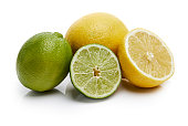 Lemons and limes isolated on white background