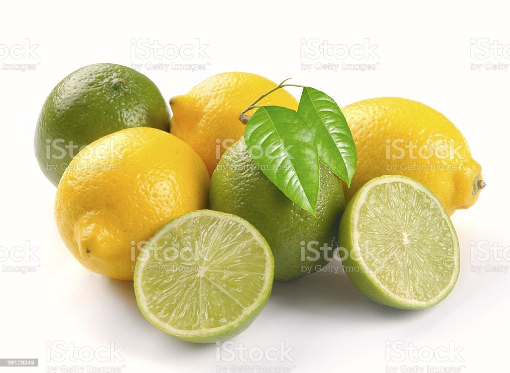 Lemon and lime with leaves royalty-free stock photo
