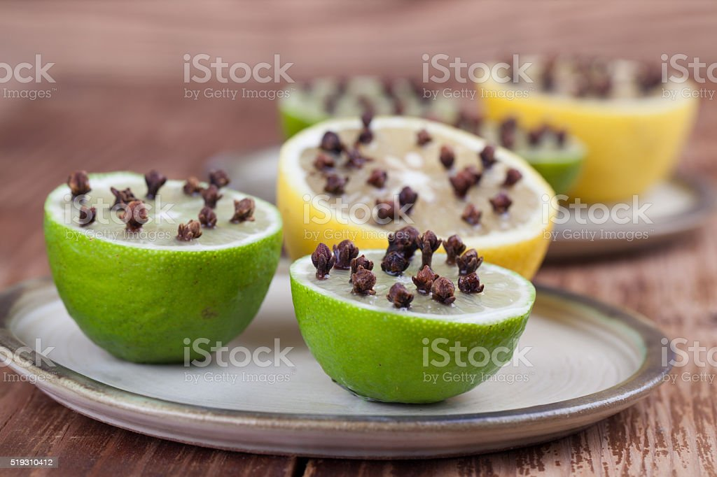 Lemon and limes with cloves, natural insect repellent stock photo
