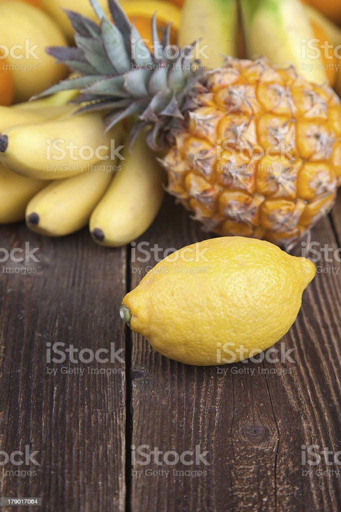 Lemon and other tropical fruits on wood royalty-free stock photo