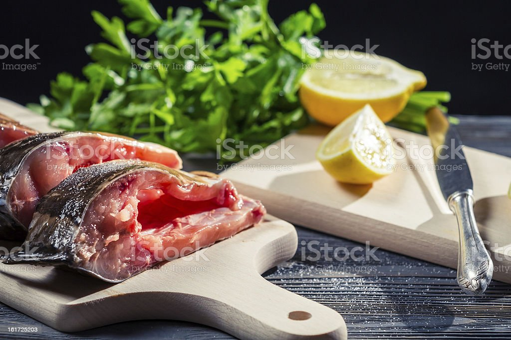 Lemon and salt as the main spice of fresh fish royalty-free stock photo