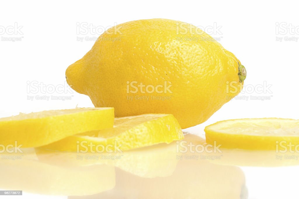 Lemon and Slices on White royalty-free stock photo