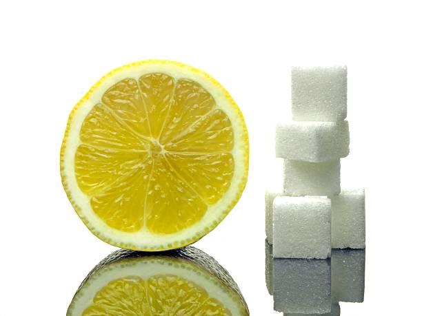 zitrone und zucker - obst kalorien stock-fotos und bilder