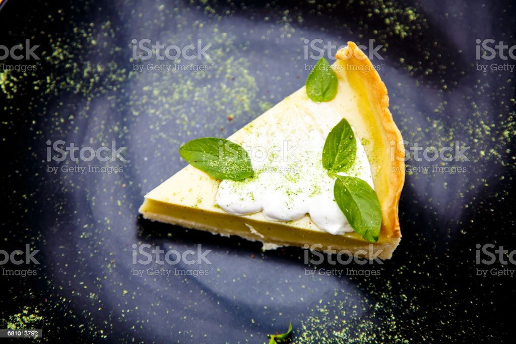 Lemon cheesecake, a slice lies on the plate. royalty-free stock photo