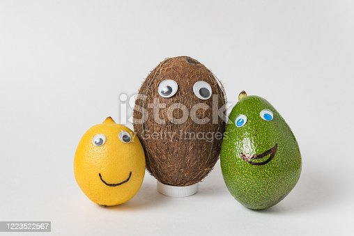 istock Lemon, coconut and avocado with funny faces. Different nationalities friendship 1223522567