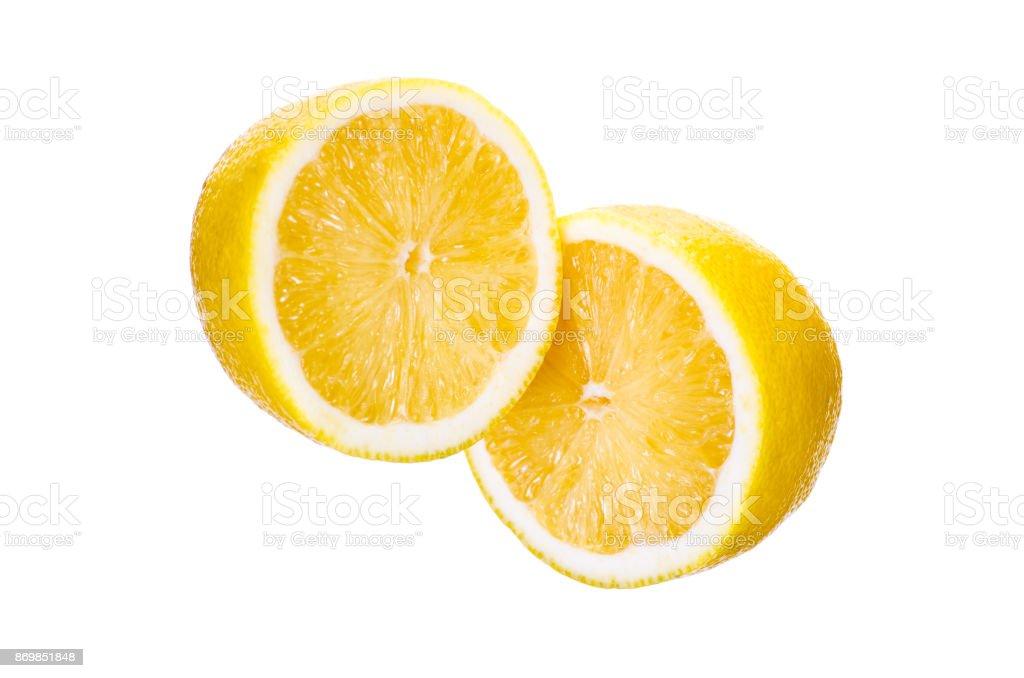 Lemon cut on a white background stock photo