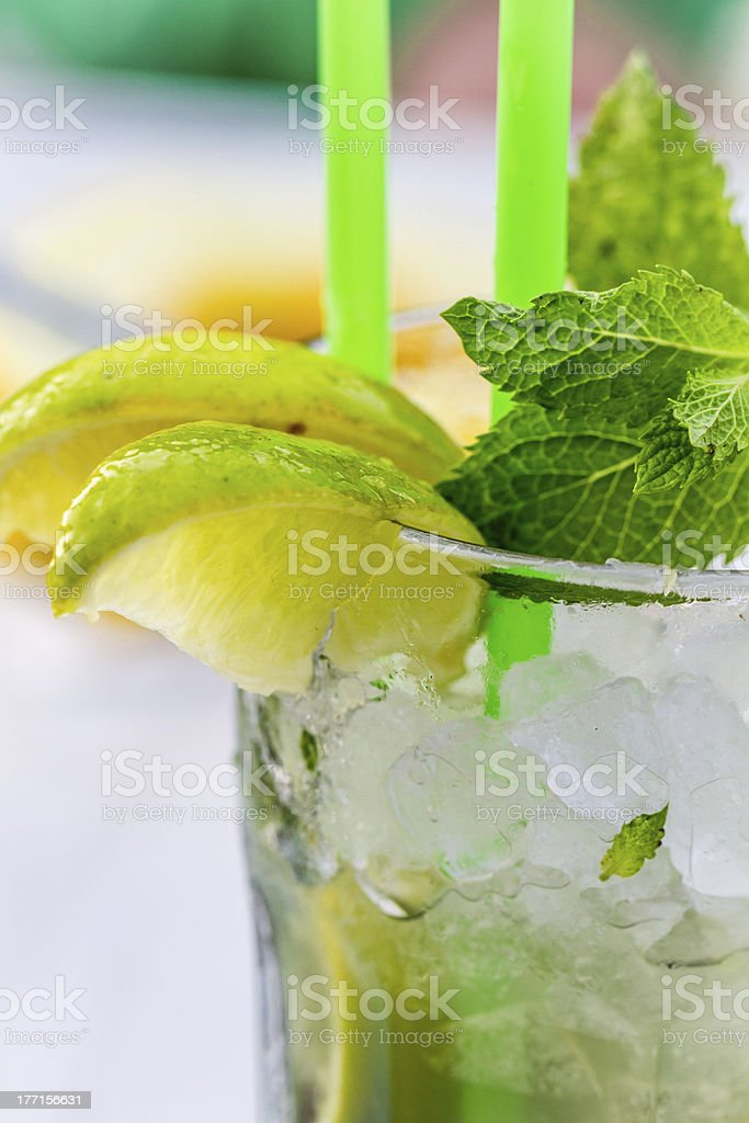 Lemon drink with lemnon, mint and ice in glass royalty-free stock photo