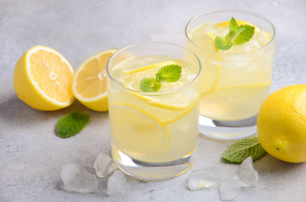 Lemon drop cocktail on a gray concrete background stock photo