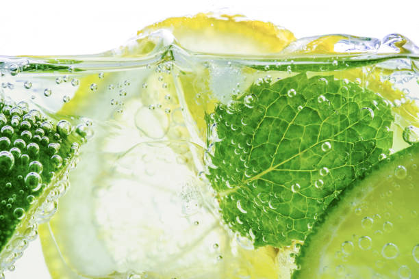 Lemon drop in fizzy sparkling water, juice refreshment stock photo