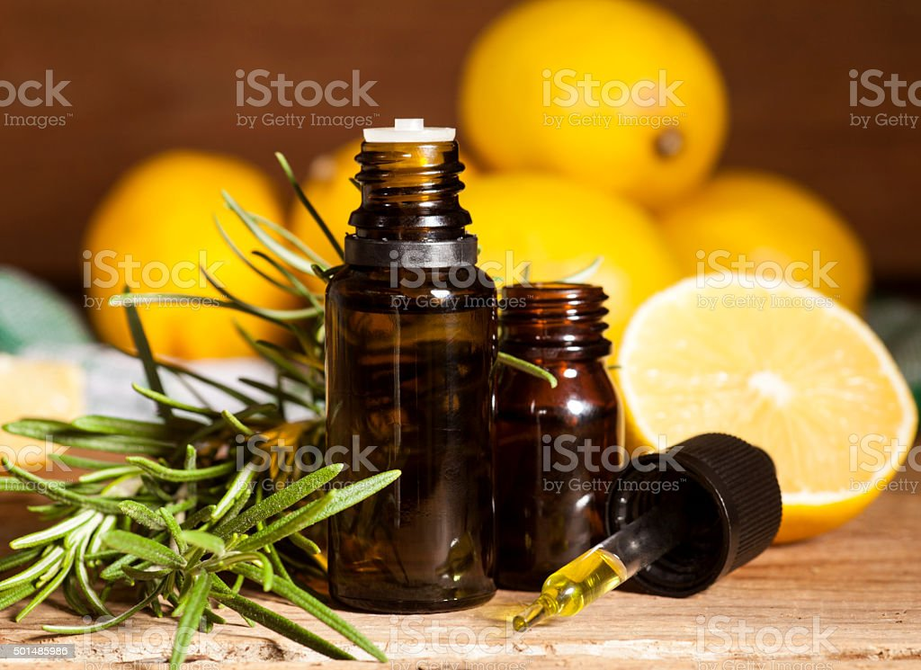 Lemon essential oil and rosemary stock photo