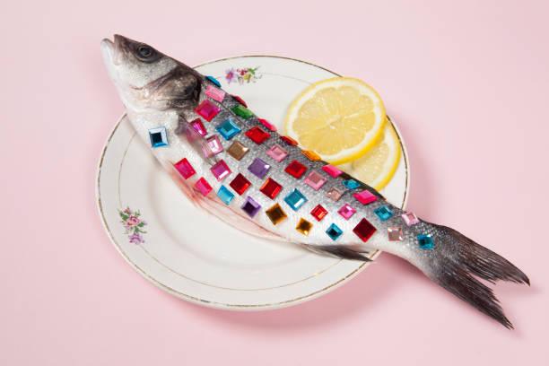 lemon fish pink plate precious gems stock photo