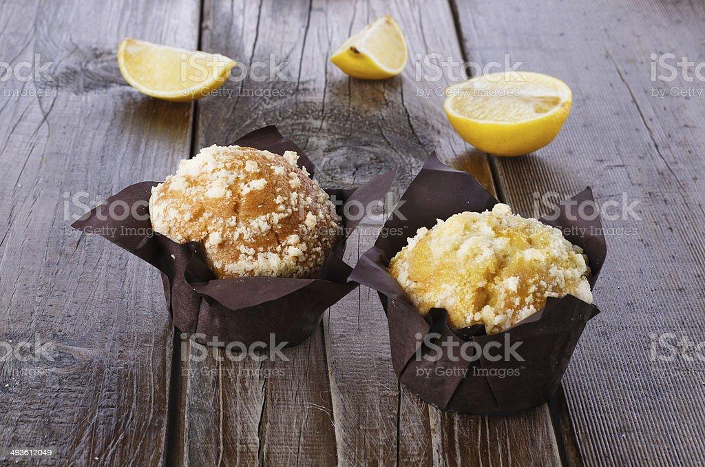 Lemon flavoured muffins on dark wooden background stock photo